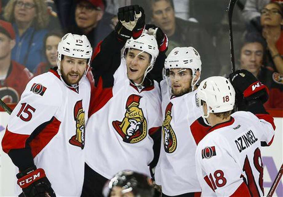 Ottawa Senators' Kyle Turris, center left,, celebrates his goal with teammates, left to right, Zack Smith, Chris Wideman, and Ryan Dzingel during the first period of an NHL hockey game against the Calgary Flames on Friday, Oct. 28, 2016, in Calgary, Alberta. (Jeff McIntosh/The Canadian Press via AP)