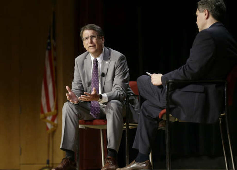 In this photo taken Wednesday, May 4, 2016 North Carolina Gov. Pat McCrory, left, make remarks concerning House Bill 2 while speaking during a government affairs conference in Raleigh, N.C. The North Carolina governor's race is everything voters anticipated it would be: expensive attack ads and barbed debates before what's essentially a referendum on the state's recent rightward tilt under Republican rule, particularly the state law limiting protections for LGBT people _ known as House Bill 2. (AP Photo/Gerry Broome, File)