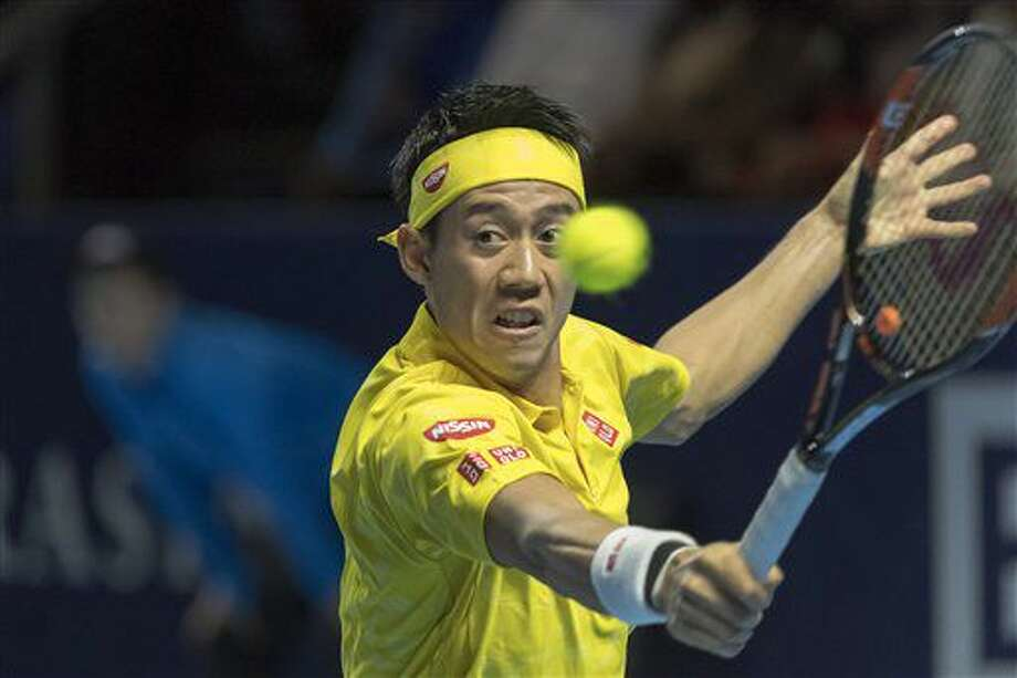 Japan's Kei Nishikori returns a ball to Luxembourg's Gilles Muller during their semifinal match at the Swiss Indoors tennis tournament at the St. Jakobshalle in Basel, Switzerland, Saturday, Oct. 29, 2016. (Georgios Kefalas/Keystone via AP)