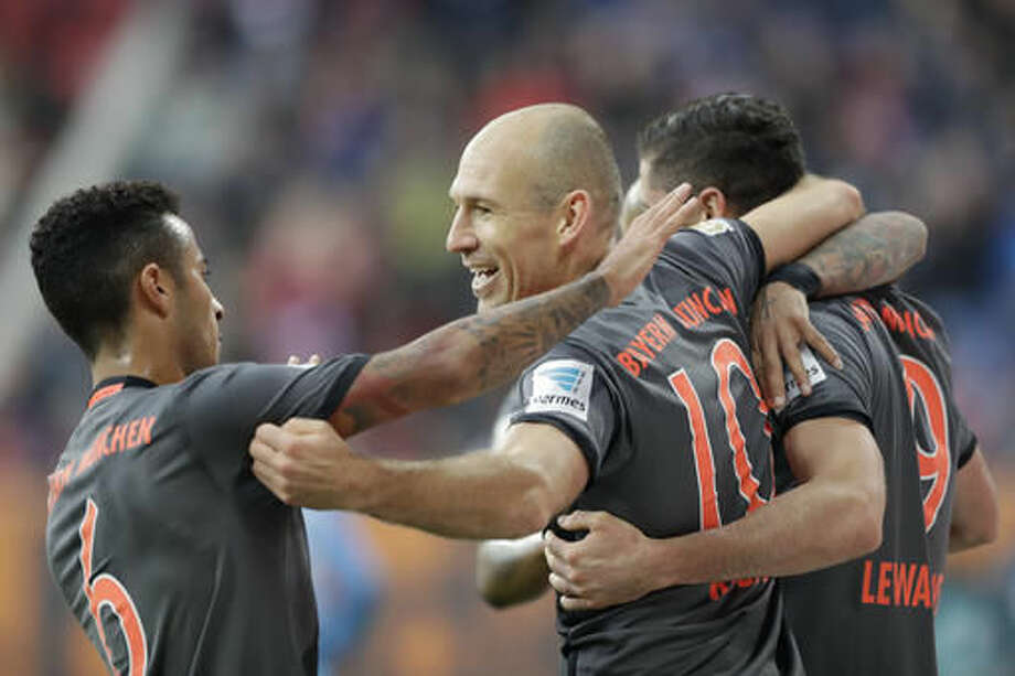 Bayern's Arjen Robben, center, celebrates with team mates Robert Lewandowski, right, and Thiago after scoring his side's second goal during the German Bundesliga soccer match between FC Augsburg and FC Bayern Munich in Augsburg, Germany, Saturday, Oct. 29, 2016. (AP Photo/Matthias Schrader)
