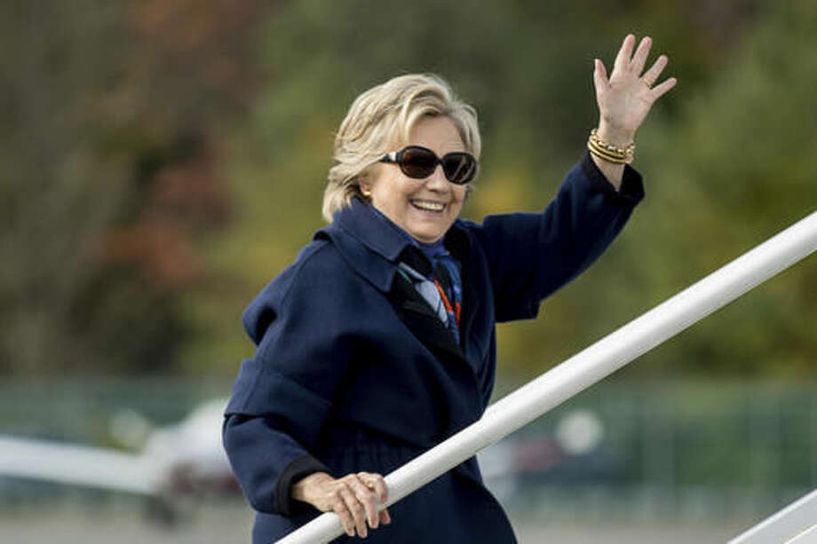 Democratic presidential candidate Hillary Clinton waves as she boards her campaign plane at Westchester County Airport in White Plains, N.Y., Saturday, Oct. 29, 2016, to travel to Florida. (AP Photo/Andrew Harnik)