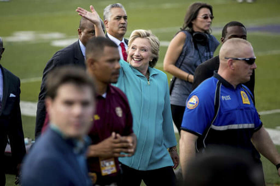 Democratic presidential candidate Hillary Clinton waves while visiting before a homecoming game for Bethune-Cookman University Wildcats as they take on the Delaware State Hornets in Daytona Beach, Fla., Saturday, Oct. 29, 2016, to attend a rally. (AP Photo/Andrew Harnik)