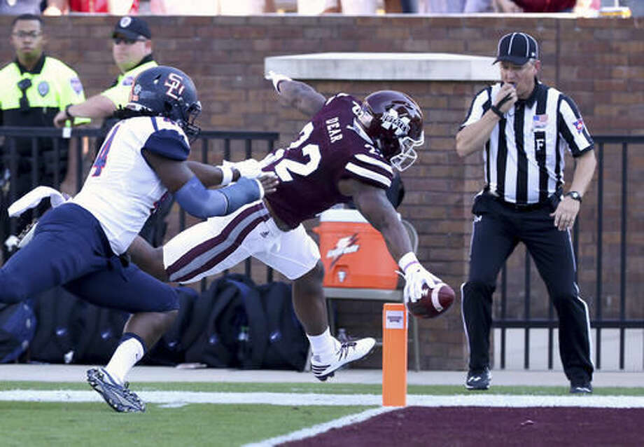 Mississippi State wide receiver Malik Dear (22) scores a touchdown as Samford linebacker Deion Pierre (44) defends during the first half of their NCAA college football game in Starkville, Miss., Saturday, Oct. 29, 2016. (AP Photo/Jim Lytle)