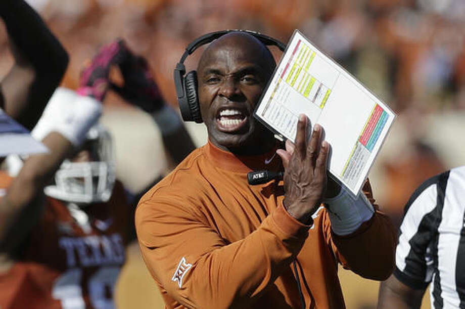 Texas head coach Charlie Strong signals to officials during the first half on a NCAA college football game against Baylor, Saturday, Oct. 29, 2016, in Austin, Texas. (AP Photo/Eric Gay)