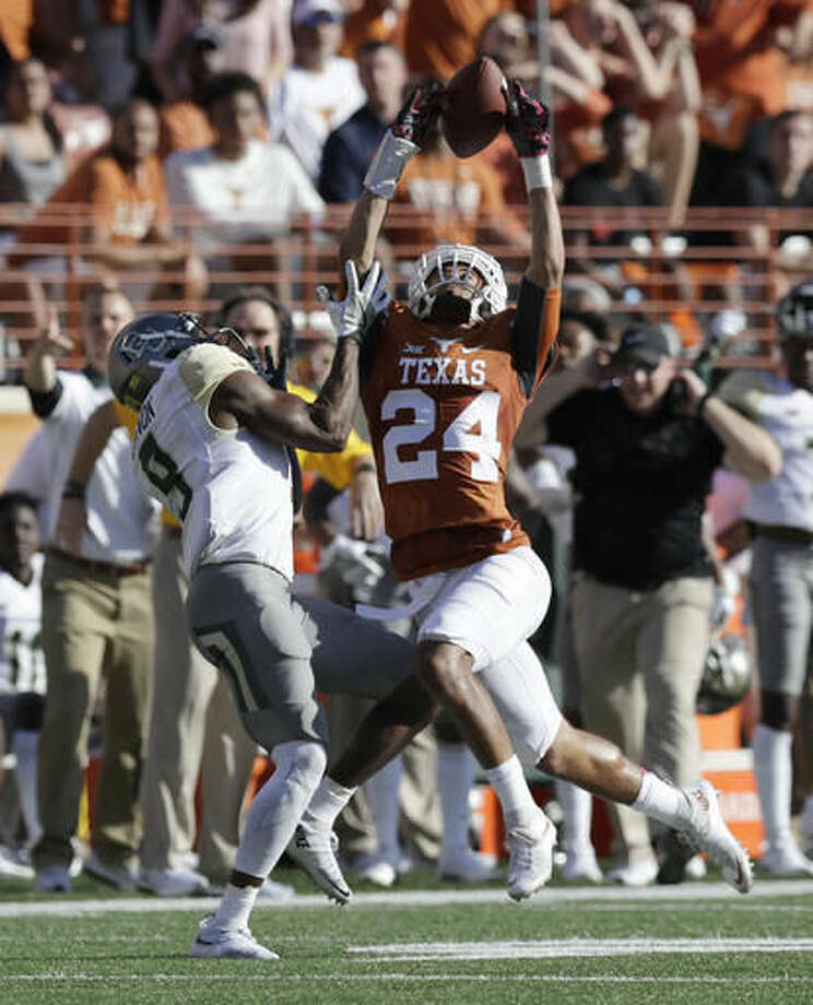 Texas cornerback John Bonney (24) breaks up a pass intended for Baylor wide receiver KD Cannon (9) during the first half on a NCAA college football game, Saturday, Oct. 29, 2016, in Austin, Texas. (AP Photo/Eric Gay)