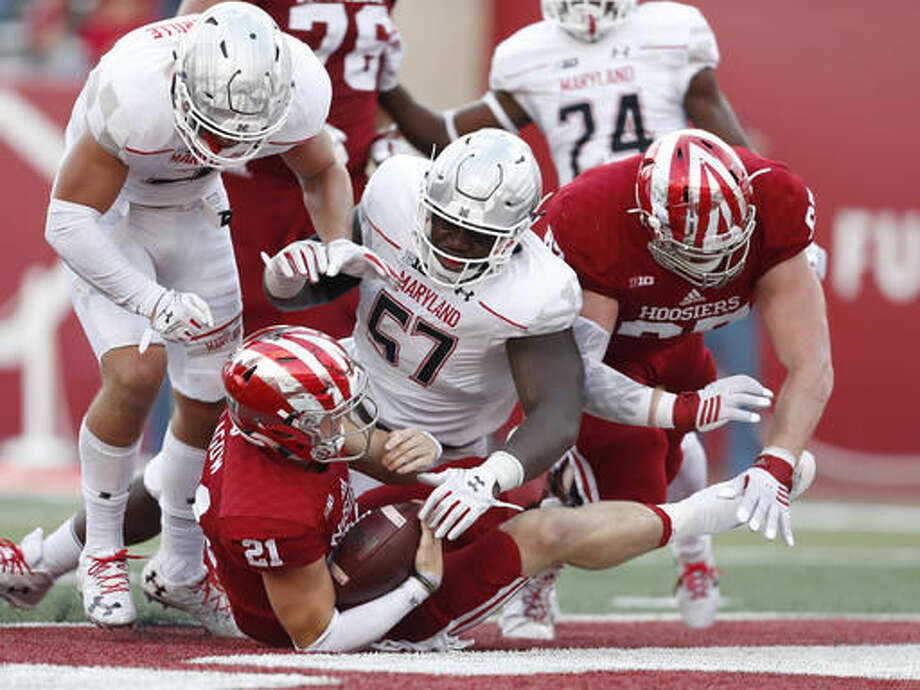 Indiana quarterback Richard Lagow (21) scores on this run against Maryland defensive lineman Kingsley Opara (57) during the second half of an NCAA college football game in Bloomington, Ind., Saturday, Oct. 29, 2016. Indiana won the game 42-36. (AP Photo/Sam Riche)