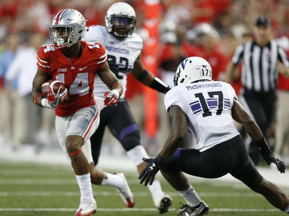 Ohio State wide receiver K.J. Hill, left, cuts upfield between Northwestern defenders Marcus McShepard, right, and Nate Hall during the second half of an NCAA college football game Saturday, Oct. 29, 2016, in Columbus, Ohio. Ohio State beat Northwestern 24-20. (AP Photo/Jay LaPrete)