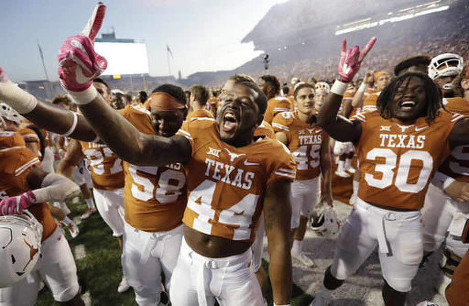 Texas players celebrate their win over Baylor in a NCAA college football game, Saturday, Oct. 29, 2016, in Austin, Texas. Texas won 35-34. (AP Photo/Eric Gay)