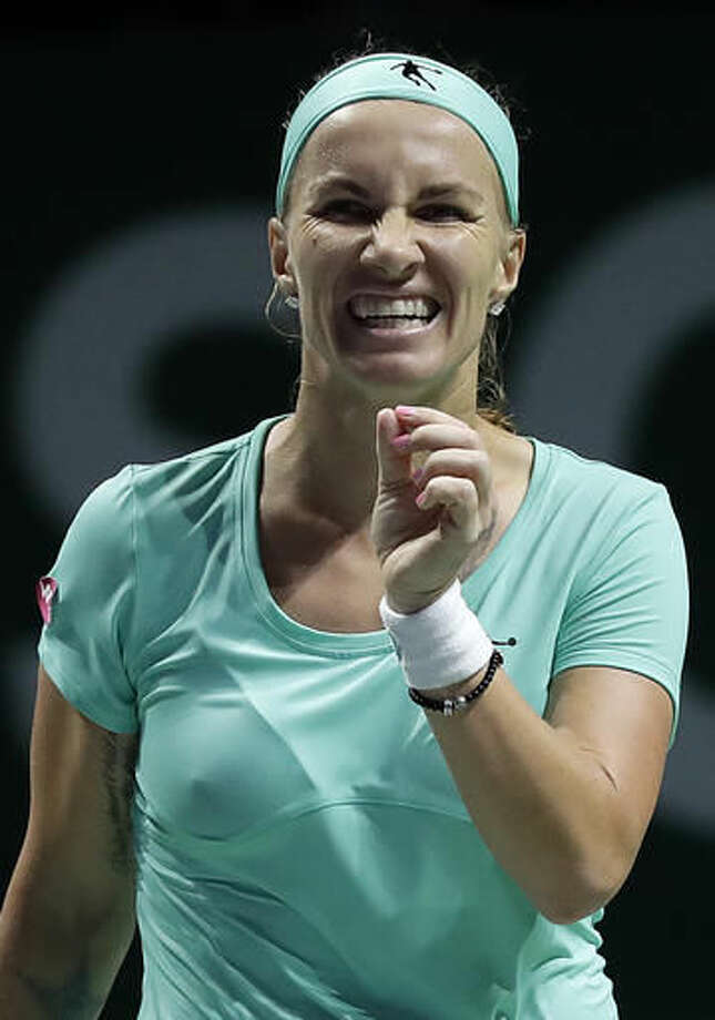 Svetlana Kuznetsova of Russia reacts after failing to score against Dominika Cibulkova of Slovakia during their singles match at the WTA tennis tournament in Singapore, Saturday, Oct. 29, 2016. (AP Photo/Wong Maye-E)