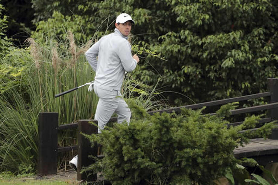 Rory McIlroy of Northern Ireland cross a wooden bridge during the 2016 WGC-HSBC Champions golf tournament at the Sheshan International Golf Club in Shanghai, China, Saturday, Oct. 29, 2016. (AP Photo/Ng Han Guan)