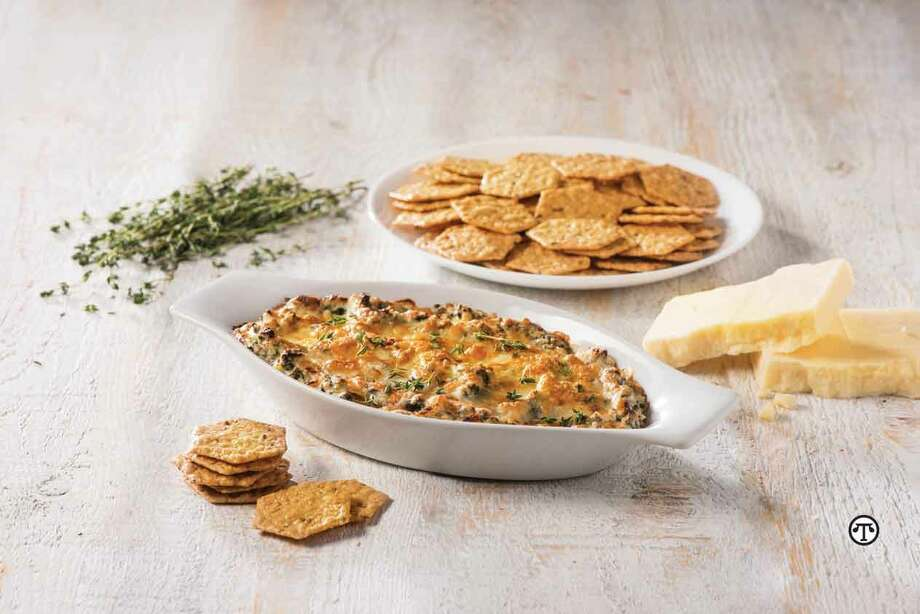 Serve this warm spinach and artichoke dip with crisp Crunchmaster® crackers for a partygoer's palate-pleaser. (NAPS)