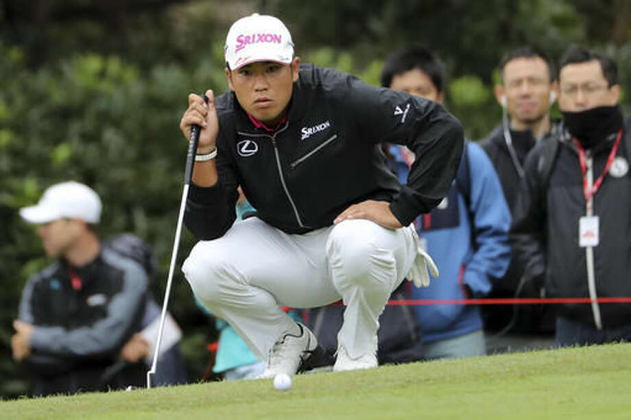 Japan's Hideki Matsuyama lines up his shot during the 2016 WGC-HSBC Champions golf tournament at the Sheshan International Golf Club in Shanghai, China, Saturday, Oct. 29, 2016. (AP Photo/Ng Han Guan)