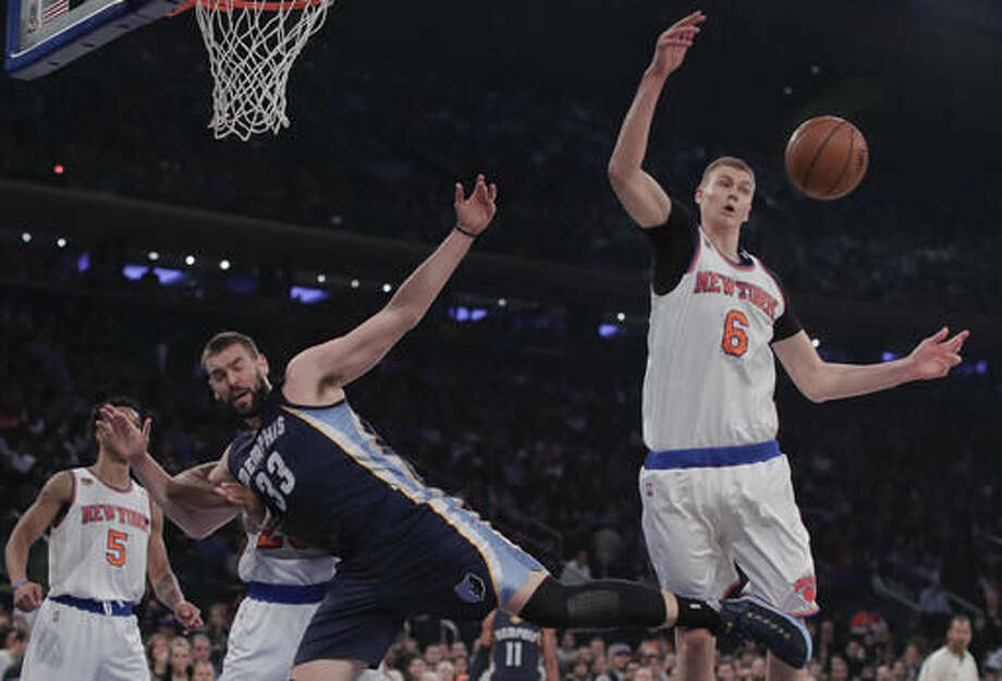 Memphis Grizzlies center Marc Gasol (33) and New York Knicks forward Kristaps Porzingis (6) battle for a rebound during the first quarter of an NBA basketball game, Saturday, Oct. 29, 2016, in New York. (AP Photo/Julie Jacobson)