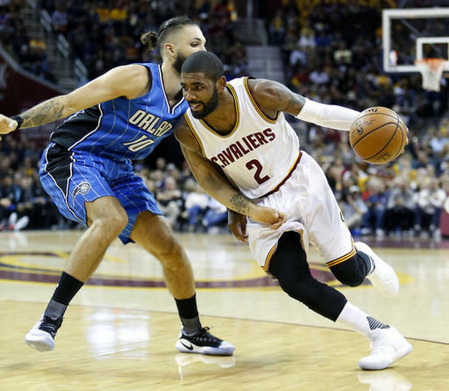 Cleveland Cavaliers guard Kyrie Irving (2) drives on Orlando Magic guard Evan Fournier (10) during the first half of an NBA basketball game Saturday, Oct. 29, 2016, in Cleveland. (AP Photo/Ron Schwane)