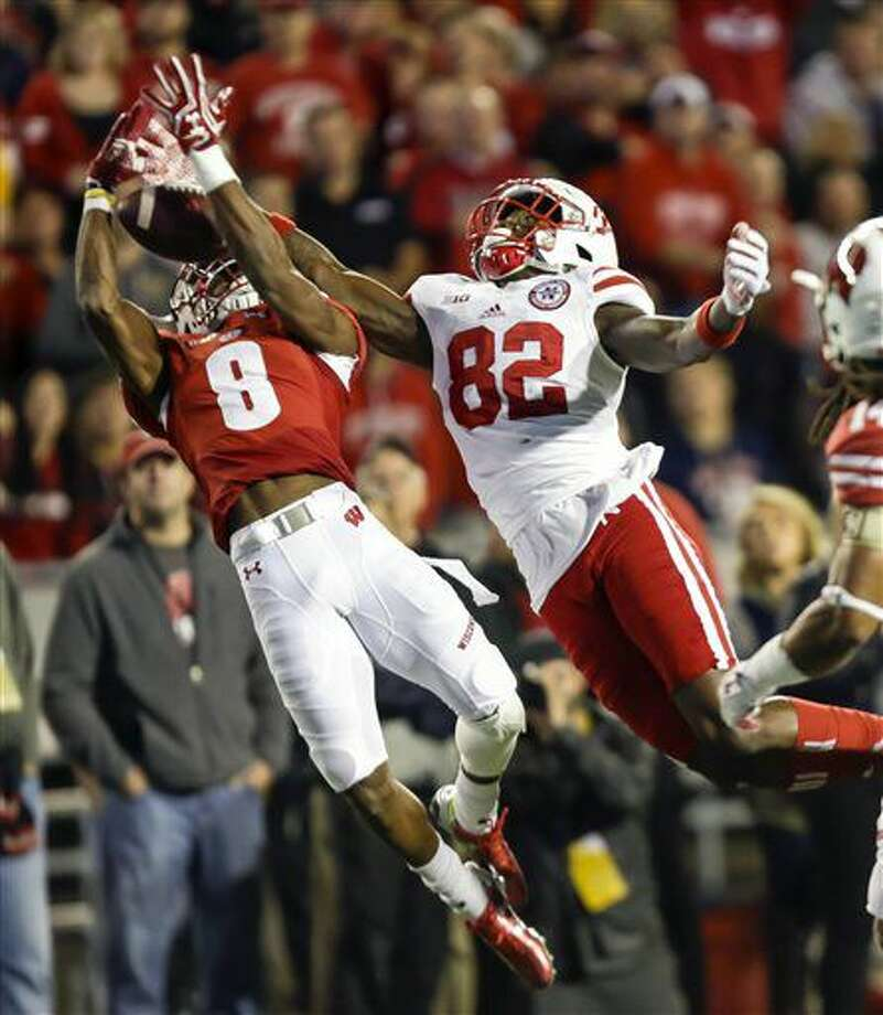 Wisconsin cornerback Sojourn Shelton (8) intercepts a pass intended for Nebraska wide receiver Alonzo Moore during the first half of an NCAA college football game Saturday, Oct. 29, 2016, in Madison, Wis. (AP Photo/Andy Manis)