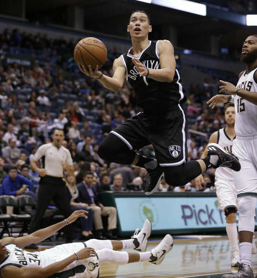 Brooklyn Nets' Jeremy Lin drives next to Milwaukee Bucks' Greg Monroe, right, during the second half of an NBA basketball game Saturday, Oct. 29, 2016, in Milwaukee. (AP Photo/Jeffrey Phelps)