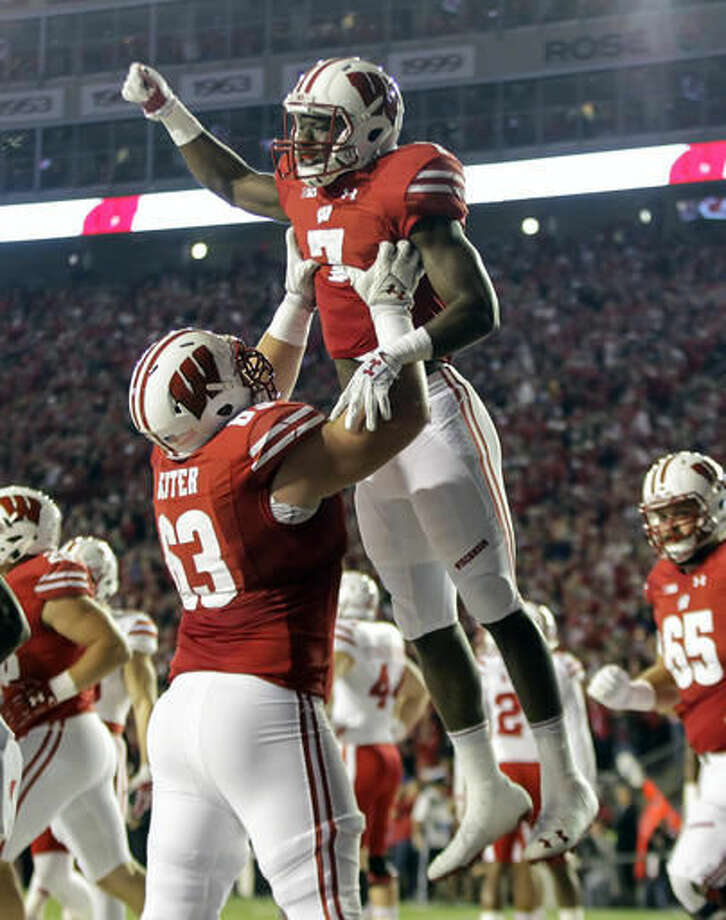 Wisconsin's Michael Deiter (63) lifts running back Bradrick Shaw (7) after Shaw scored a touchdown against Nebraska during the first half of an NCAA college football game Saturday, Oct. 29, 2016, in Madison, Wis. (AP Photo/Andy Manis)