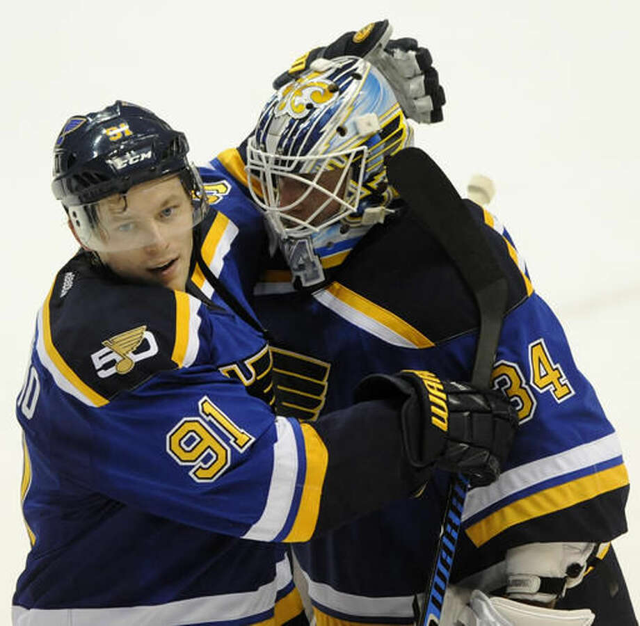 St. Louis Blues' Vladimir Tarasenko (91), of Russia, and Blues' goalie Jake Allen (34) celebrate a victory over the Los Angeles Kings in an NHL hockey game, Saturday, Oct. 29, 2016, in St. Louis. (AP Photo/Bill Boyce)