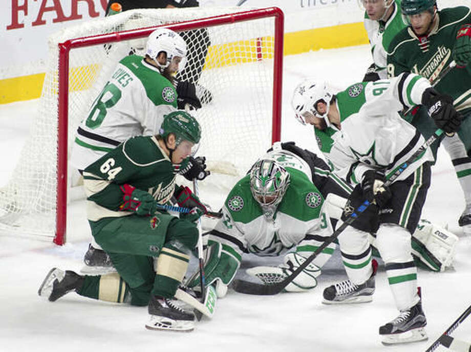 Dallas Stars goalie Kari Lehtonen, of Finland (32) dives to cover the loose puck as Minnesota Wild center Mikael Granlund, of Finland (64) tries to gain control during the first period of an NHL game, Saturday, Oct. 29, 2016, in St. Paul, Minn. The Dallas Stars Tyler Seguin (91) and Patrick Eaves (18) defend on the play. (AP Photo/Paul Battaglia)