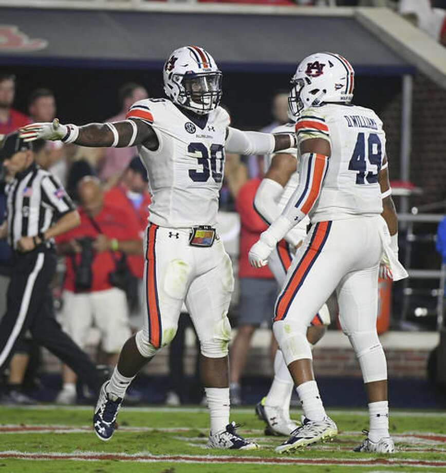 Auburn linebackers Tre' Williams (30) and Darrell Williams (49) celebrate after an incomplete Mississippi pass during the first half of an NCAA college football game in Oxford, Miss., Saturday, Oct. 29, 2016. (AP Photo/Thomas Graning)