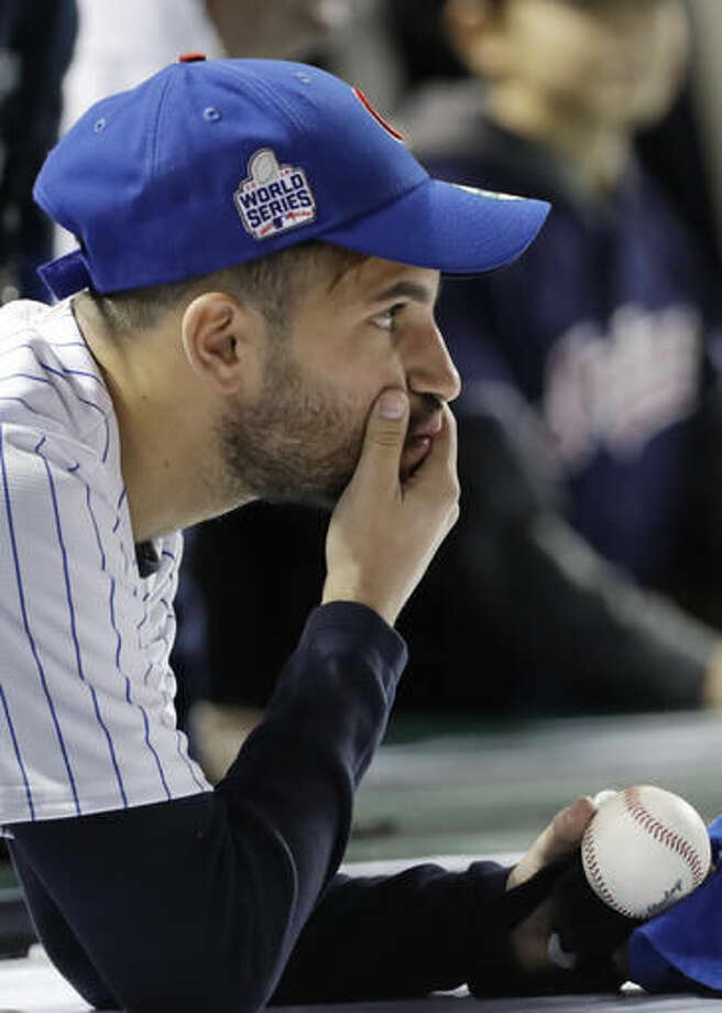 A Chicago Cubs fan reacts after Game 4 of the Major League Baseball World Series against the Cleveland Indians Saturday, Oct. 29, 2016, in Chicago. The Indians won 7-2 to take a 3-1 lead in the series. (AP Photo/David J. Phillip)