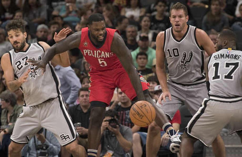 New Orleans Pelicans guard Lance Stephenson (5) tangles with San Antonio Spurs' Jonathon Simmons (17), David Lee (10) and Nico Laprovittola, of Argentina, during the second half of an NBA basketball game, Saturday, Oct. 29, 2016, in San Antonio. San Antonio won 98-79. (AP Photo/Darren Abate)