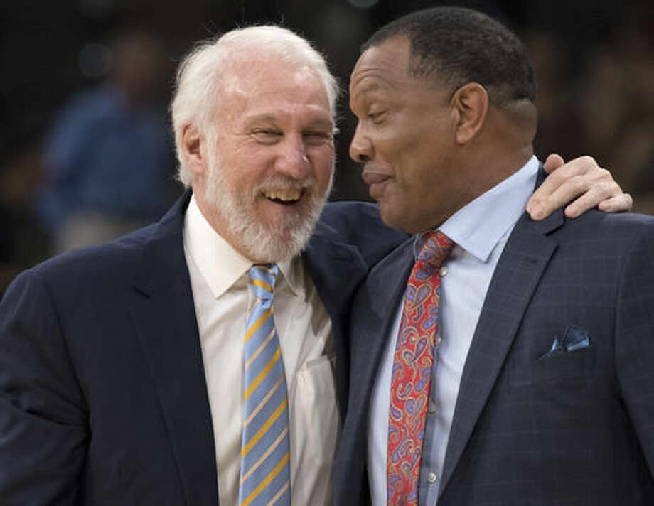 San Antonio Spurs head coach Gregg Popovich, left, and New Orleans Pelicans head coach Alvin Gentry talk on the court after an NBA basketball game, Saturday, Oct. 29, 2016, in San Antonio. San Antonio won 98-79. (AP Photo/Darren Abate)