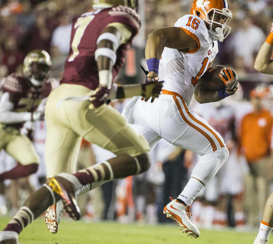 Clemson tight end Jordan Leggett carries against Florida State's Ermon Lane after a reception during the first half of an NCAA college football game in Tallahassee, Fla., Saturday, Oct. 29, 2016. (AP Photo/Mark Wallheiser)