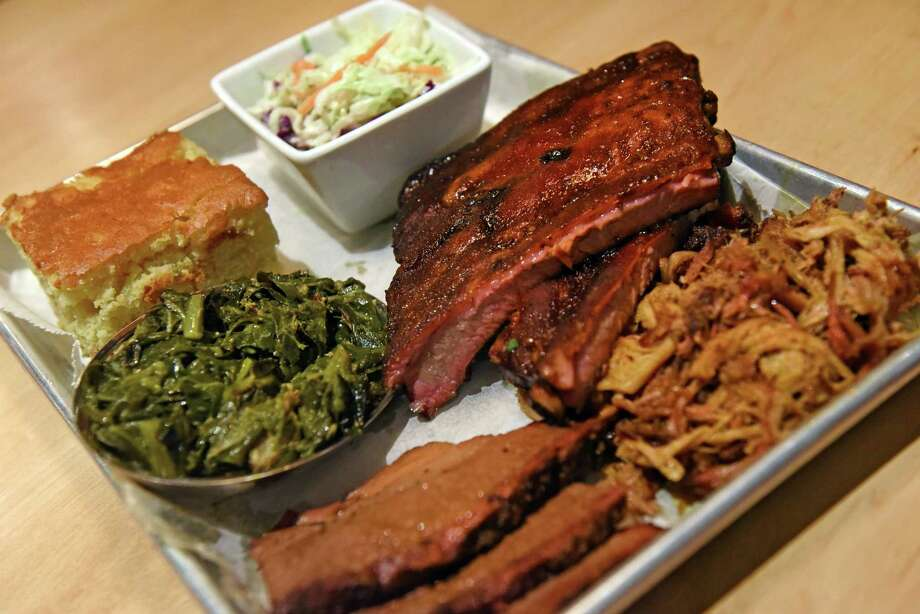 A barbecue platter at the Warehouse BBQ on Tuesday Nov. 29, 2016 in Colonie, N.Y.  (Michael P. Farrell/Times Union) Photo: Michael P. Farrell / 20038968A