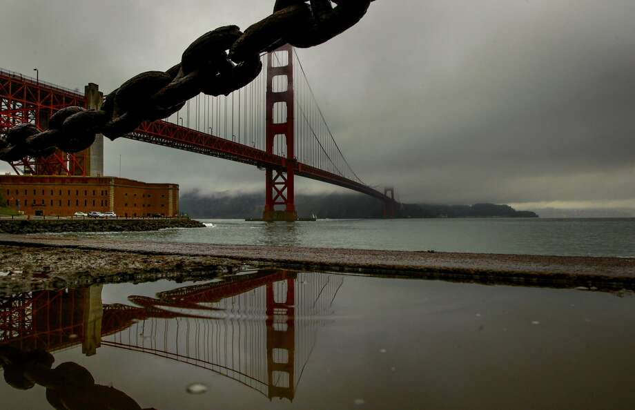 Clouds fill the sky above the Golden Gate Bridge during a light rain across San Francisco, California, on Wednesday November 30, 2016. Photo: Michael Macor, The Chronicle