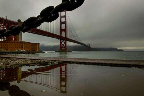 Clouds fill the sky above the Golden Gate Bridge during a light rain across San Francisco, California, on Wednesday November 30, 2016.