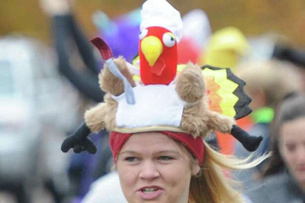 Wearing a turkey hat, New Canaan resident Caroline Corey runs in the Shippan Turkey Trot at Shippan Point in Stamford Nov. 24. The Thankgiving Day fun run, now in its 16th year, drew about 300 participants dressed in a variety of wacky and holiday-themed costumes. An estimated $10,000 raised by the run goes 100 percent to meal programs at Stamford's Pacific House.