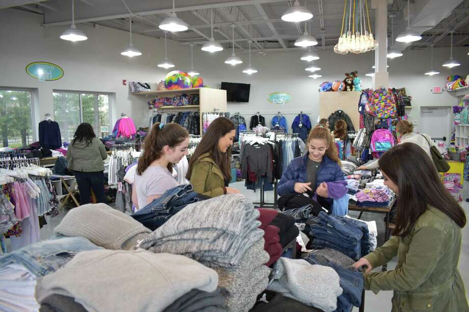 Westport residents Lily Valente, second from left, and sisters Tallulah, Coco and Daisy Laska made the Westport store Groove their second stop during an afternoon of shopping on Black Friday, Nov. 25. Photo: Alexander Soule / Hearst Connecticut Media