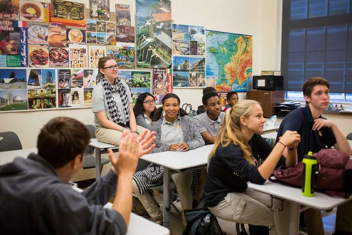 WASHINGTON, DC - OCTOBER 23: Students listen to teacher Carl Lyon (not pictured) during a sophomore advisory period at Washington Latin Public Charter School, in Northwest Washington, D.C., October 23, 2015. The school has a mission of including diverse families, but it has served a lower and lower share of low-income families over time as its performance and reputation have climbed. This year, the school is offering bus transportation to students in Anacostia as a way to boost diverse enrollment. (Photo by Allison Shelley/For The Washington Post via Getty Images)