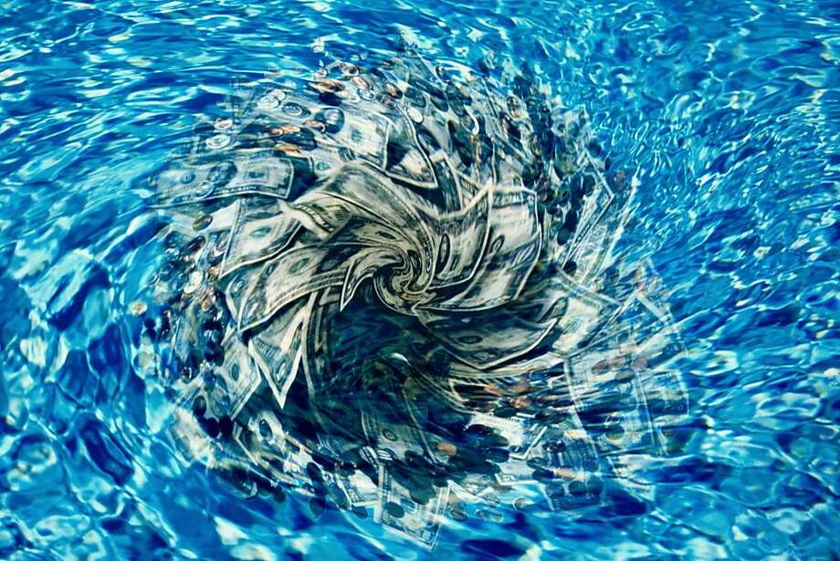 A wife is worried about her husband's ability to throw money down the drain. Photo: Art Montes De Oca, Getty Images