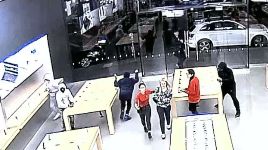 In security video released by San Francisco police, hooded robbers are seen ransacking an Apple Store on two occasions in the last week. Photo: San Francisco Police Department