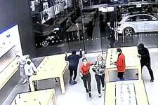In security video released by San Francisco police, hooded robbers are seen ransacking an Apple Store on two occasions in the last week.