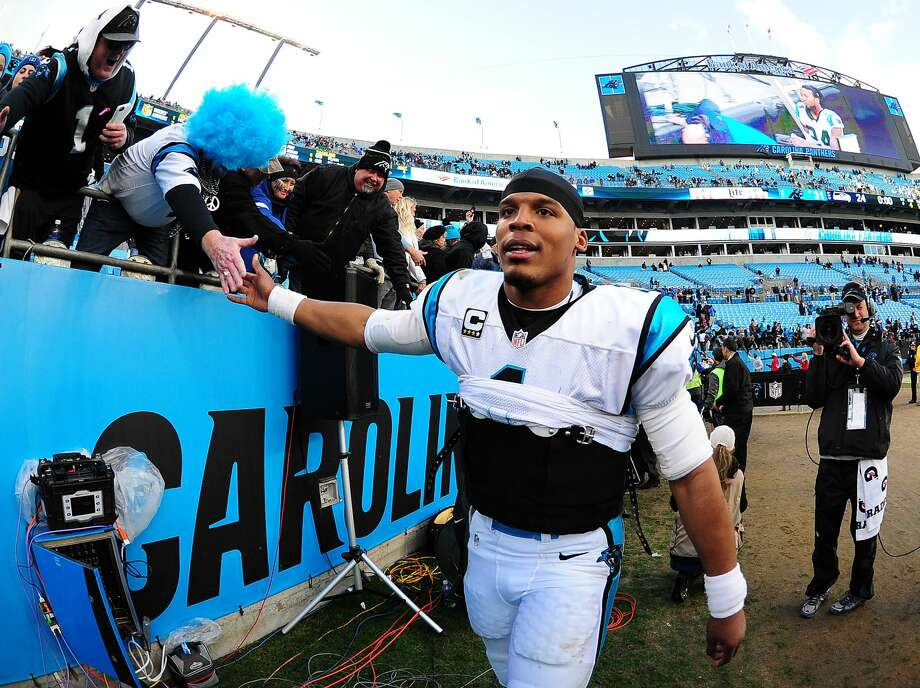 Cam Newton of the Carolina Panthers celebrates with fans after the NFC Divisional Playoff Game against the Seattle Seahawks at Bank Of America Stadium on January 17, 2016 in Charlotte, North Carolina. (Photo by Scott Cunningham/Getty Images) Photo: Scott Cunningham/Getty Images