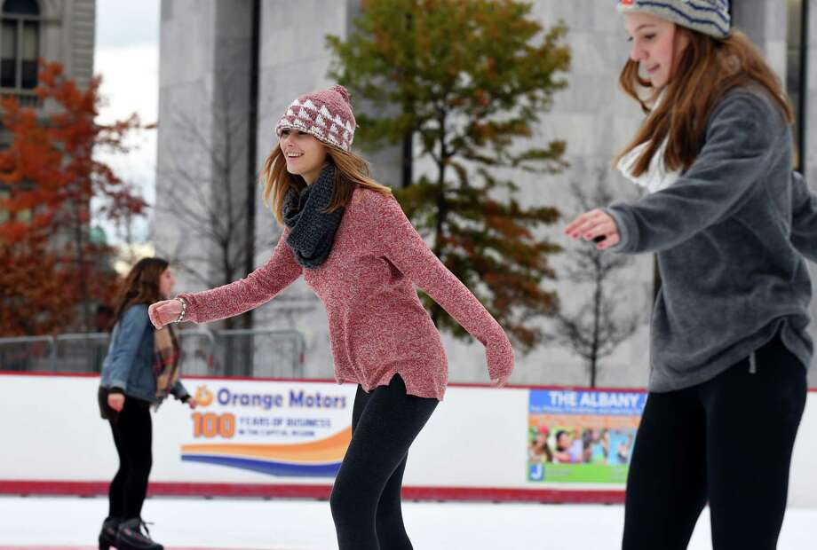 St. Rose students Emily Janssen, left, and Ally Lizotte skate on the season opening day of the Empire State Plaza ice rink on Friday Dec. 2, 2016 in Albany, N.Y.  (Michael P. Farrell/Times Union) Photo: Michael P. Farrell / 20039031A