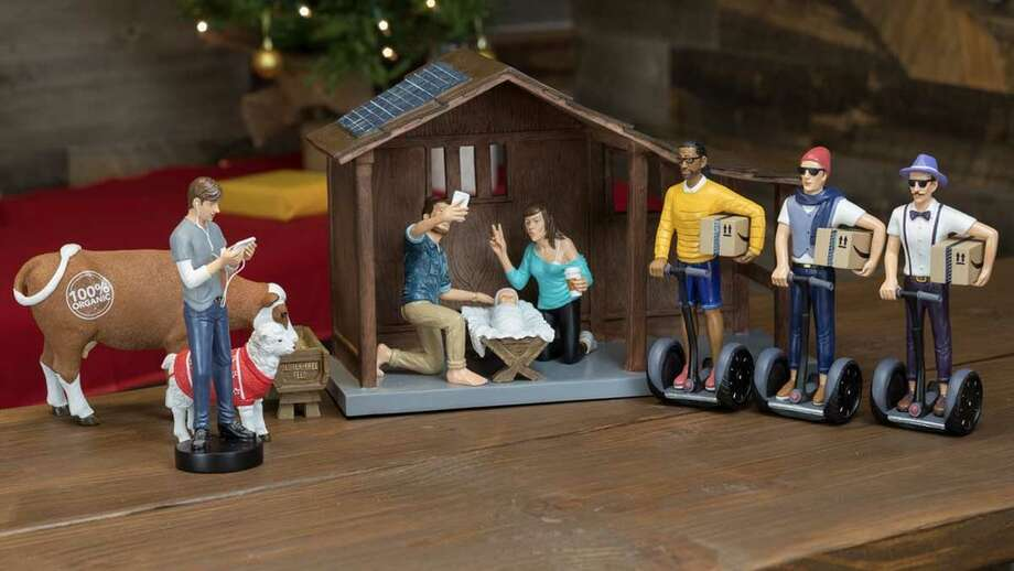 The Hipster Nativity turns tradition on its head with Joseph and Mary taking a selfie with baby Jesus while three Segway-riding wise men  are on hand to deliver gifts in amazon.com boxes.