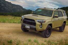 Toyota's 2016 4Runner TRD Pro has projector-beam headlights, fog lights and privacy glass. What's harder to see is the quarter-inch-thick stamped aluminum front skid plate, as well as similar protection for the fuel tank and transfer case. -- Jeff Yip photo