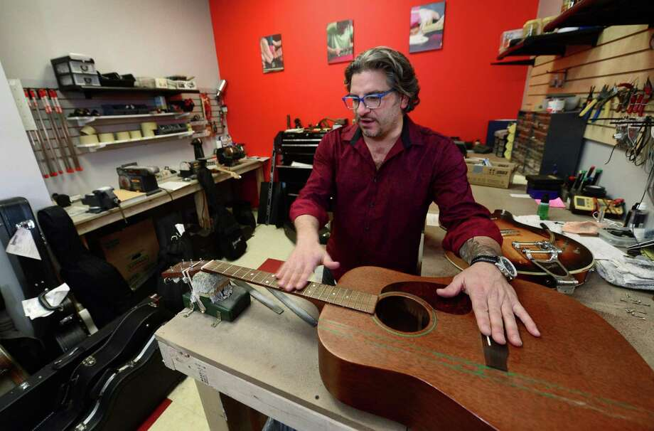 Bobby Balestra, owner of Giuliano's Music Center, in his recently opened his shop on Thursday, December 1, 2016, in Nowalk, Conn. Photo: Erik Trautmann / Hearst Connecticut Media / Norwalk Hour