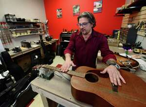 Bobby Balestra, owner of Giuliano's Music Center, in his recently opened his shop on Thursday, December 1, 2016, in Nowalk, Conn.