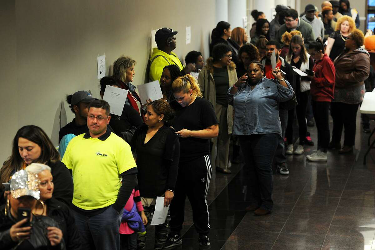 Hundreds of people wait in line to register and to vote on Election Day at the Morton Government Center, in Bridgeport, Conn. Nov. 8, 2016.