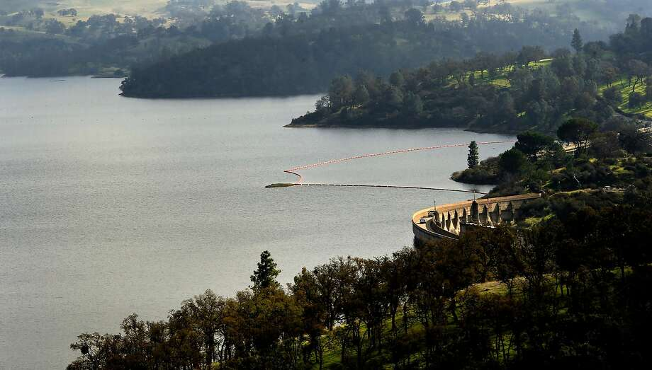 Lake Pardee in Amador County, seen brim-full in 2016, also is brimming now with thousands of pounds of fish, waiting for anglers to catch them. Photo: Michael Macor, The Chronicle