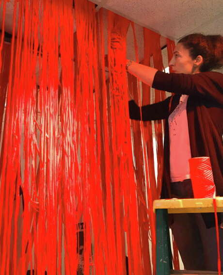 Spanish artist Amaya Bombin installing an art project at the Instituto de Cultura Hispanica de Houston (Institute of Hispanic Culture) on December 3, 2016. Photo: Courtesy Of Amaya Bombin