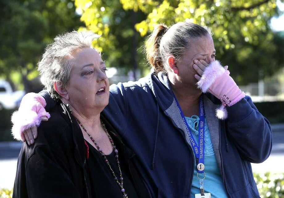 Zen Martinsen (left) weeps with her friend Paula Garcia during a moment of silence for victims of the Dec. 2, 2015, terrorist assault in San Bernardino. Photo: Nick Ut, Associated Press