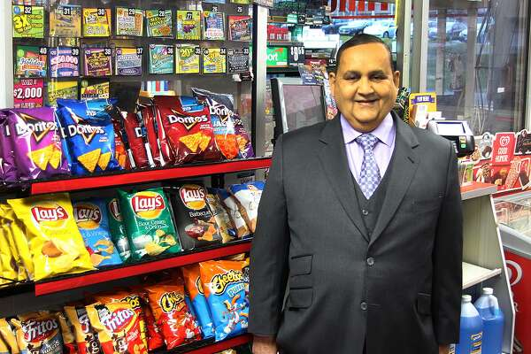 Naresh Gandhi stands in his gas station Orbit Fuel on Lake Street Ext. in Danbury on Thursday, Dec. 1, 2016.
