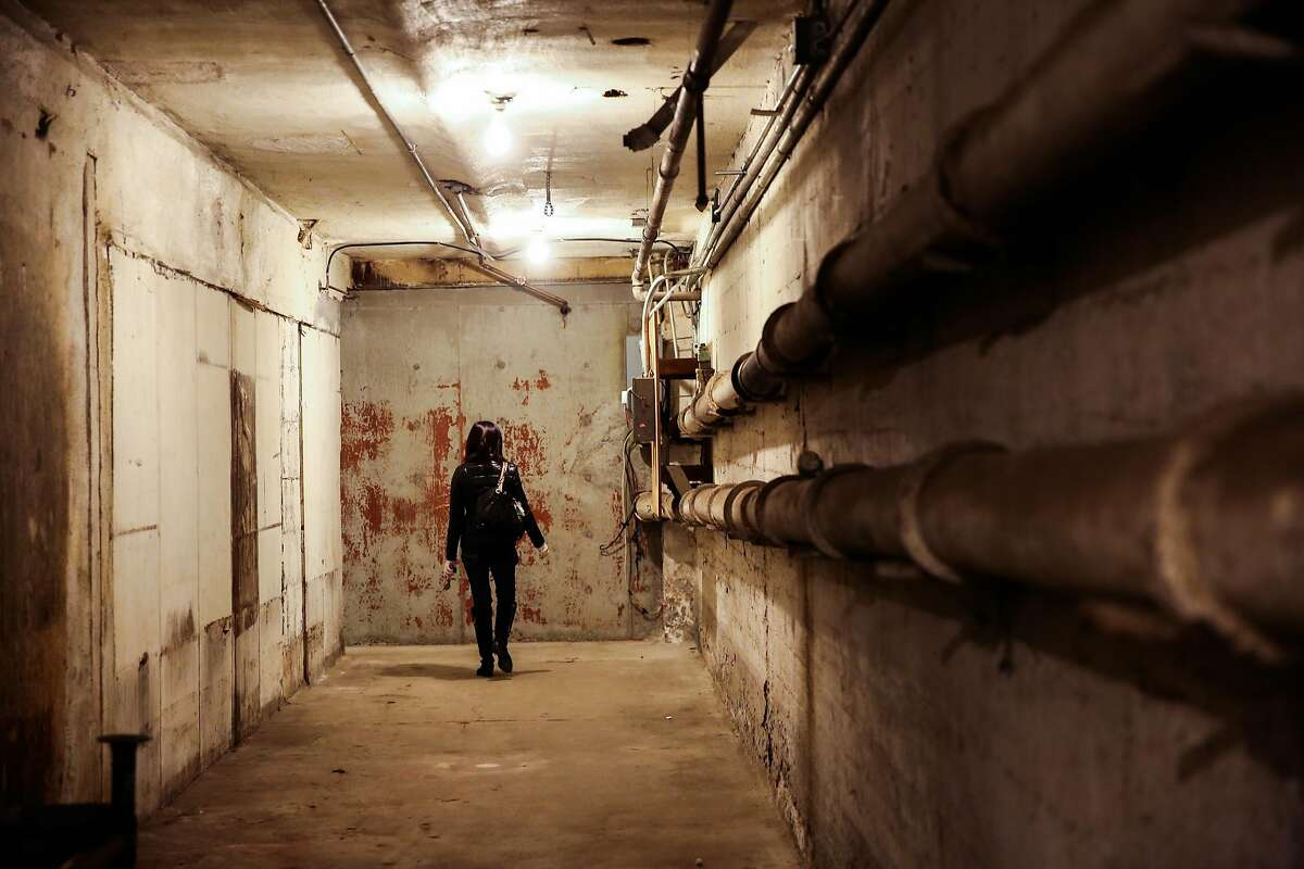 Project manager Michelle Lin walks through the basement of a property that is part of the development at 950 Market Street, which plans to make a hotel and condos, in San Francisco, California, on Wednesday, November 30, 2016.