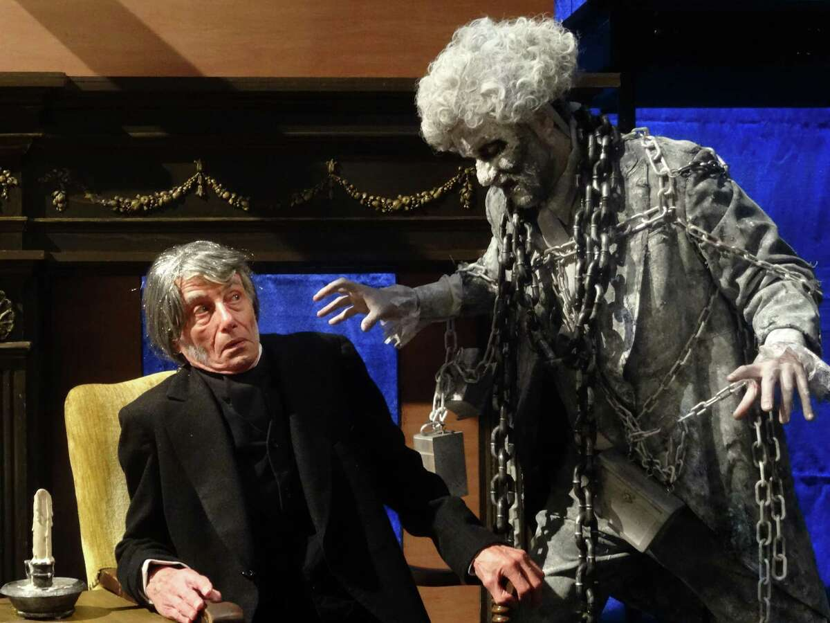Ted Yudain, left, as Scrooge, and Mike Shanahan, as Marley, in the Curtain Call production of